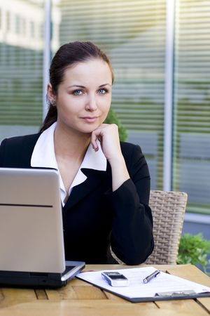 Woman using laptop outdoors Stock Photo - 3498827