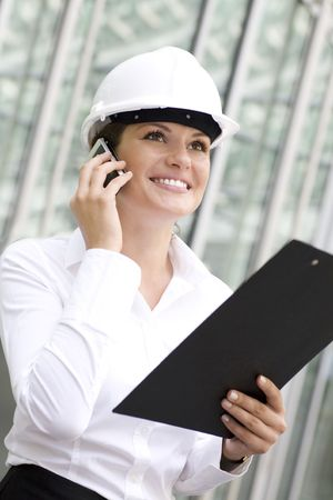 architect plans: Female architect holding a clipboard Stock Photo