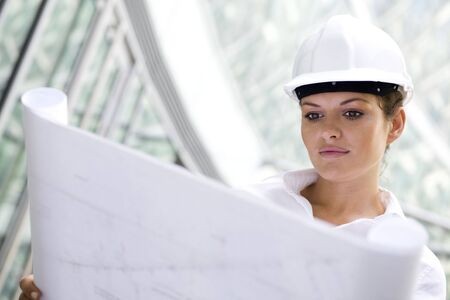 architect plans: Female architect holding blueprints Stock Photo