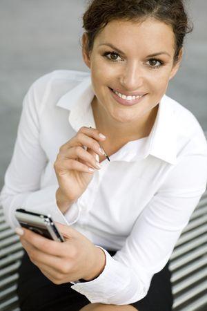 Businesswoman using palmtop photo
