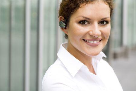 Businesswoman wearing bluetooth photo