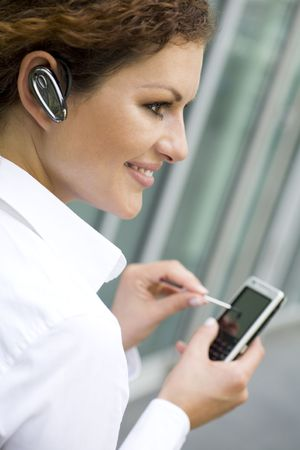 bluetooth: Businesswoman using palmtop