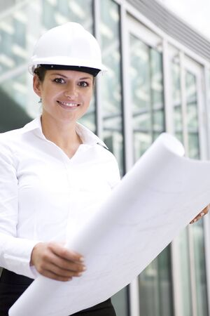 Female architect holding blueprints Stock Photo - 3545152