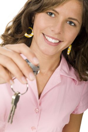 Young woman holding house keys photo
