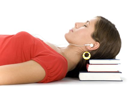 earphone: Girl lying on pile of books