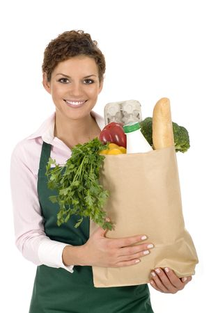 Woman in apron holding grocery bag photo