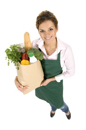 grocer: Woman in apron holding grocery bag Stock Photo