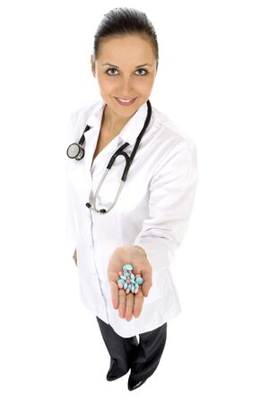 Female doctor holding pills photo