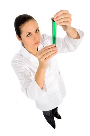 Female lab worker holding up test tube photo