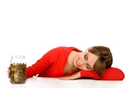 Woman looking at coins in jar  photo