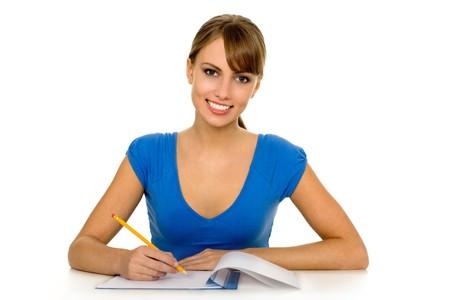 Female student doing homework Stock Photo - 3978797