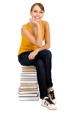 Woman sitting on stack of books Stock Photo