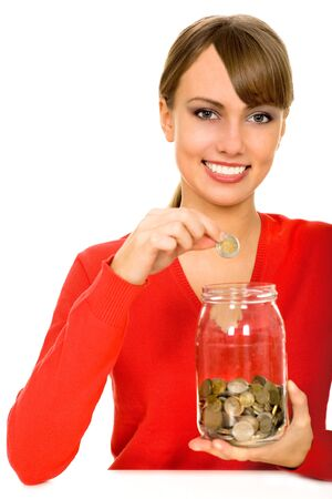 Woman putting coin in jar photo