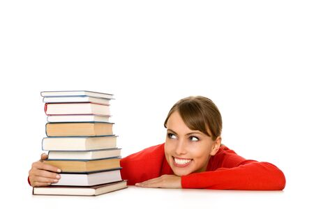 Young woman with stack of books photo
