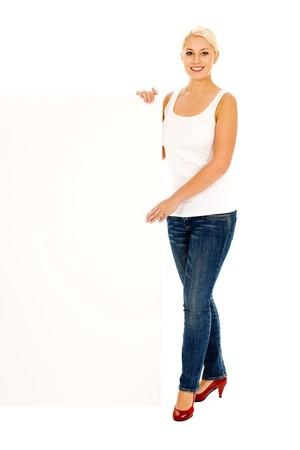 Woman holding blank billboard photo