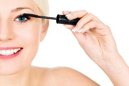 Woman applying mascara Stock Photo - 4274051