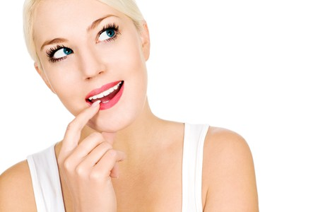 Woman with finger on lip, looking up Stock Photo - 4274049