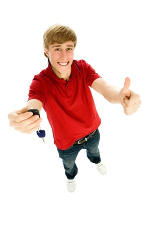 high key: Young man holding car keys Stock Photo