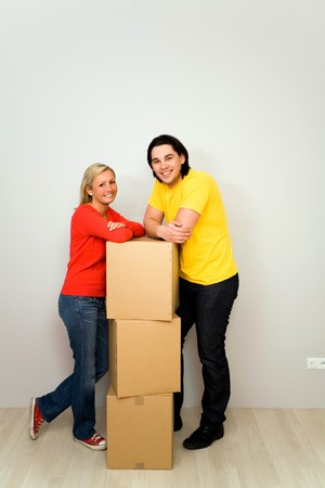 Couple leaning on packing boxes Stock Photo - 4503991