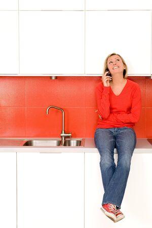 Woman sitting on kitchen counter  photo