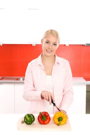 Woman cutting vegetables in the kitchen photo