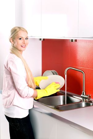 washing dishes: Woman washing dishes