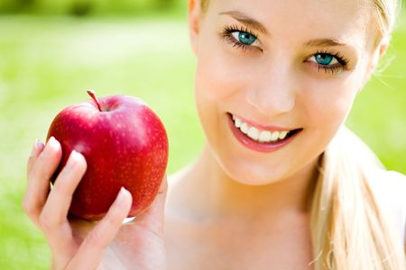 Young woman holding red apple Stock Photo - 4756357
