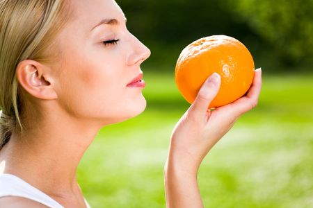 Woman holding an orange photo