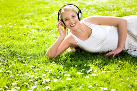 Woman listening to music Stock Photo - 4814559