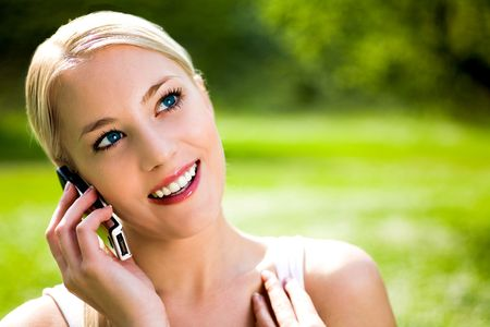 Woman using mobile phone outdoors Stock Photo - 4871479