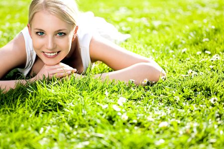 Young Woman Lying on the Grass Stock Photo - 4871474