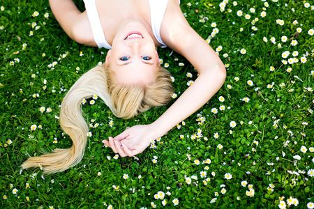 Young Woman Lying on the Grass photo