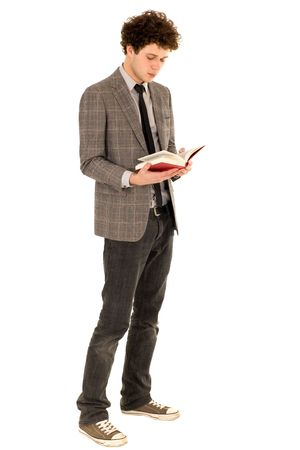man holding book: Young man reading book
