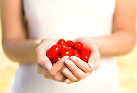 cherry tomatoes: Woman holding cherry tomatoes