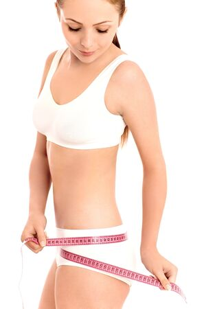 Woman measuring her waist Stock Photo - 5125351