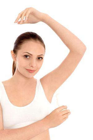 underarm: Young woman applying deodorant  Stock Photo
