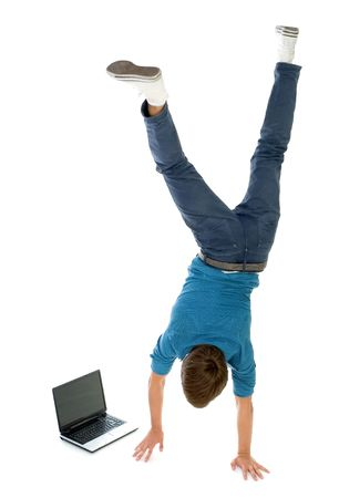 upside down: Young man upside down using laptop