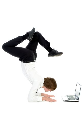 contortionist: Businessman doing handstand and using laptop
