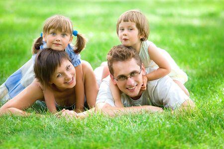 Family lying on grass Stock Photo - 5303204