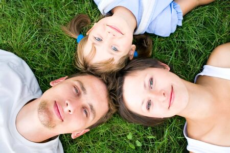 Family lying on grass Stock Photo - 5303257