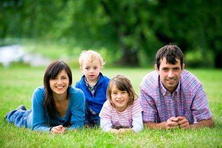 Happy family outdoors photo