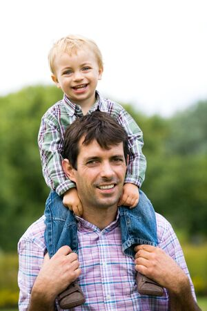 piggyback ride: Father Giving Son Piggyback Ride Stock Photo