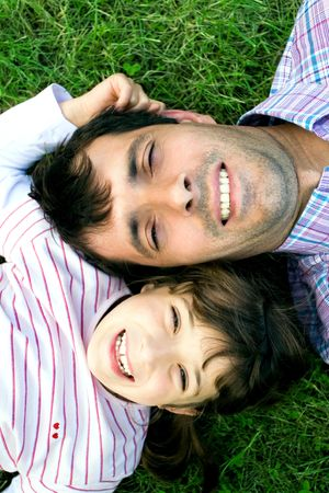 Father and daughter on grass photo