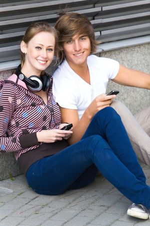 Teens with cellphones photo