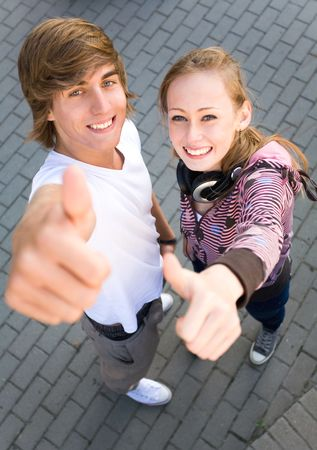 thumbs up: Teens With Thumbs Up