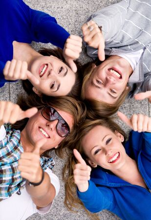 Teens With Thumbs Up Stock Photo - 5610585