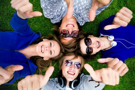 Teens With Thumbs Up Stock Photo - 5610586