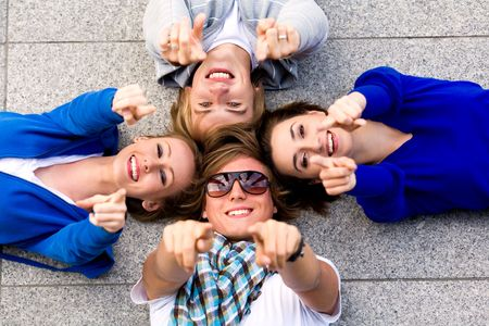 Teens pointing their fingers photo