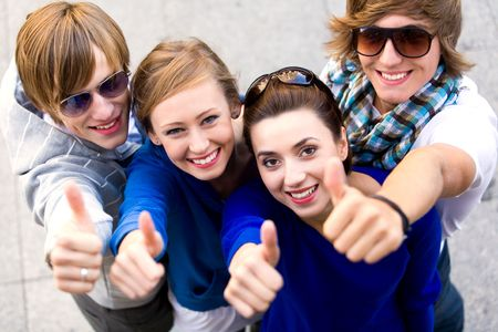 Friends showing thumbs up sign Stock Photo - 5644823