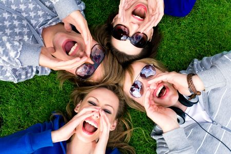 Group of friends shouting photo